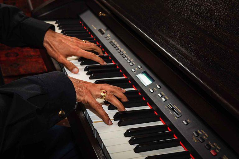 A man plays a digital piano.