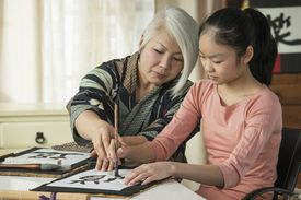 Kanji characters being taught between family members