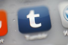Tumblr icon on a phone screen
