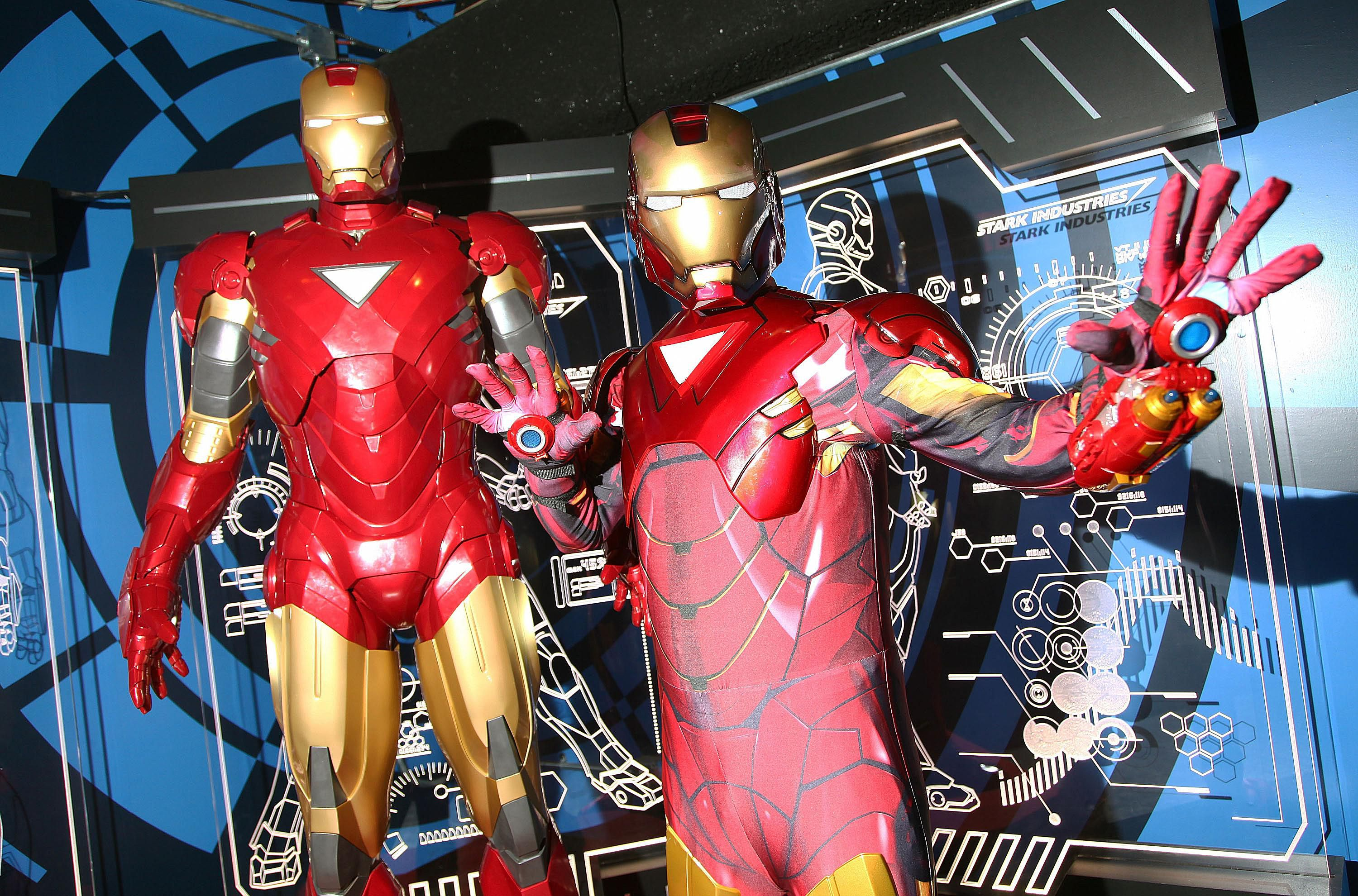 A costumed Iron Man poses with a wax Iron Man at Madame Tussauds in New York City.