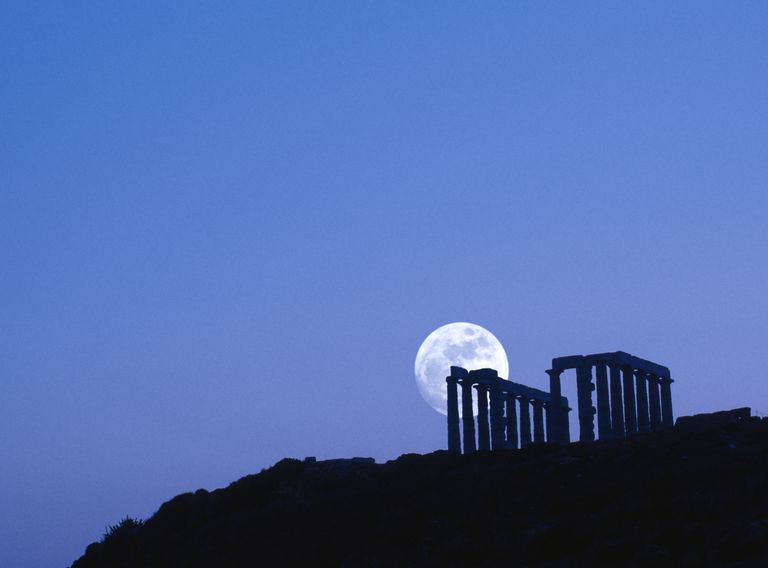 Greece, silhouette of Sounion temple with moon rise