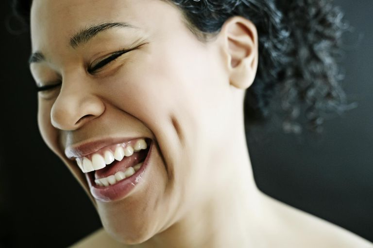 Nude mixed race woman smiling