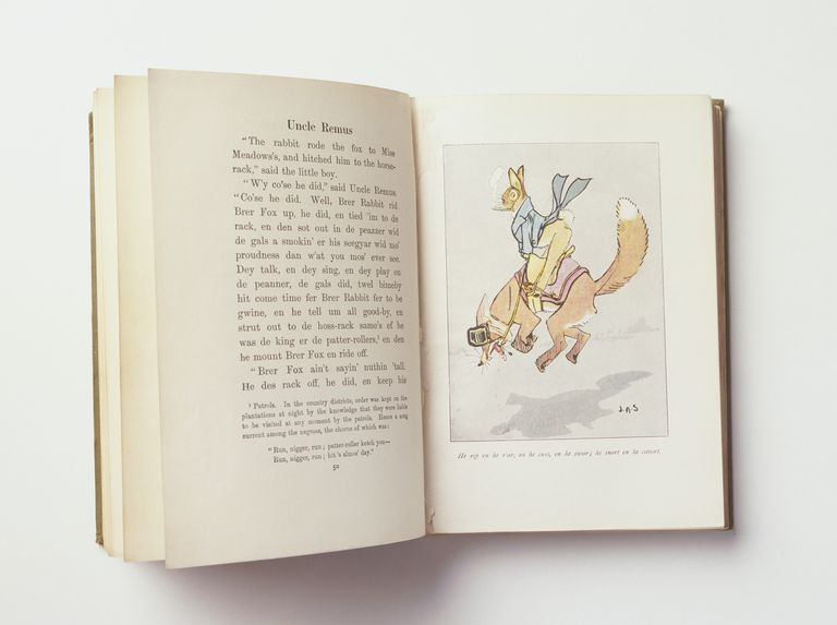 Old childrens' reading book, open at page with illustration and text.