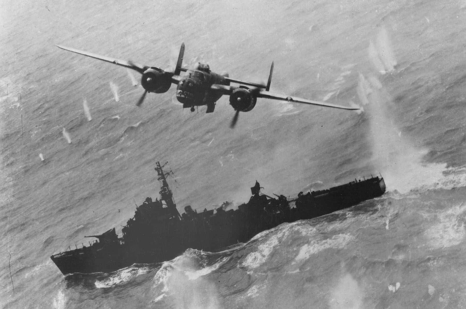 B-25 Mitchell flying over a Japanese warship.