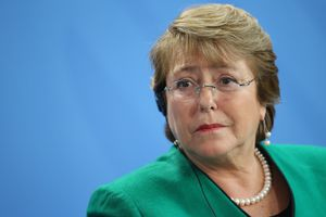 Chilean President Bachelet head shot on a blue background.
