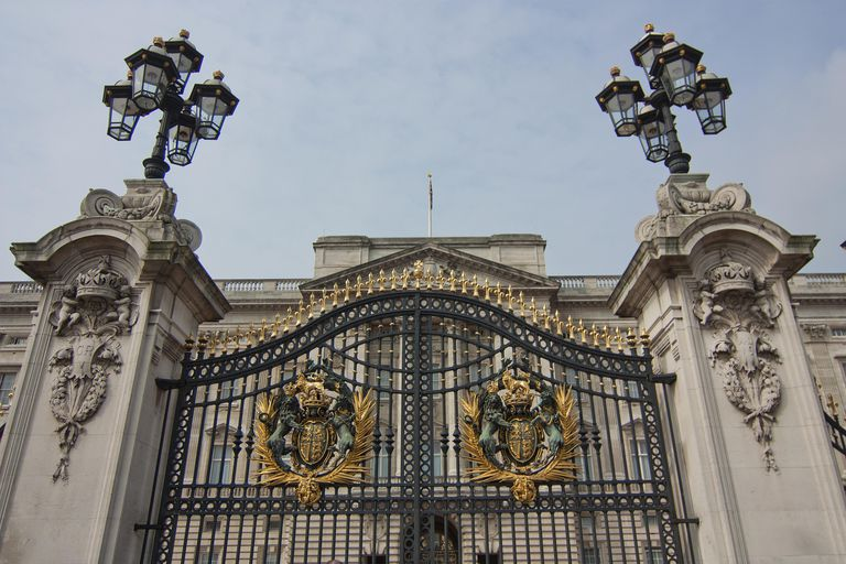 National Royal Symbols of England and Front Door of Buckingham Palace, London, Britain