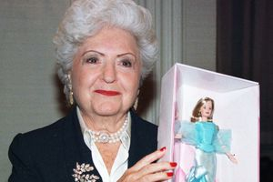 Ruth Handler holds a Barbie doll, 1999.