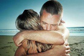 Costa Rica, Dominical Beach, couple embracing, close-up