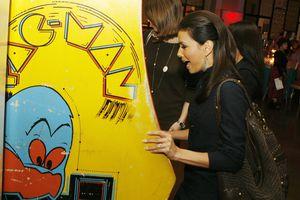 Actress Eva Longoria playing Pac-Man at the afterparty.