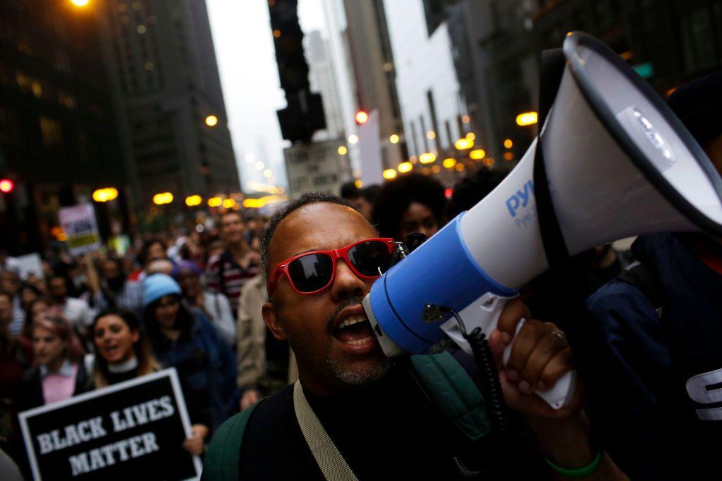 Demonstrators celebrate the verdict in the murder trial of Chicago police officer Jason Van Dyke on October 5, 2018.