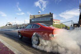 Red Race Car on Drag Strip
