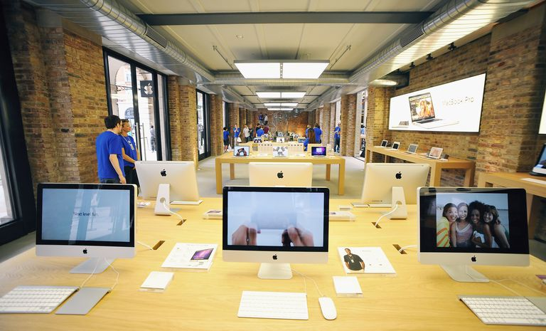 Tables of Apple Mac products on display at the Apple Store in London