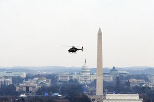Helicopter flying over Washington, D.C. on an overcast day.
