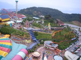 Aerial view of a theme park during the daytime.