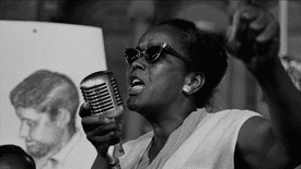 Ella Baker with microphone