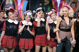 Gwen Stefani with Harajuku Girls during Gwen Stefani Visits MTV's ''TRL'' - December 10, 2004 at MTV Studios, Times Square in New York City, New York, United States.