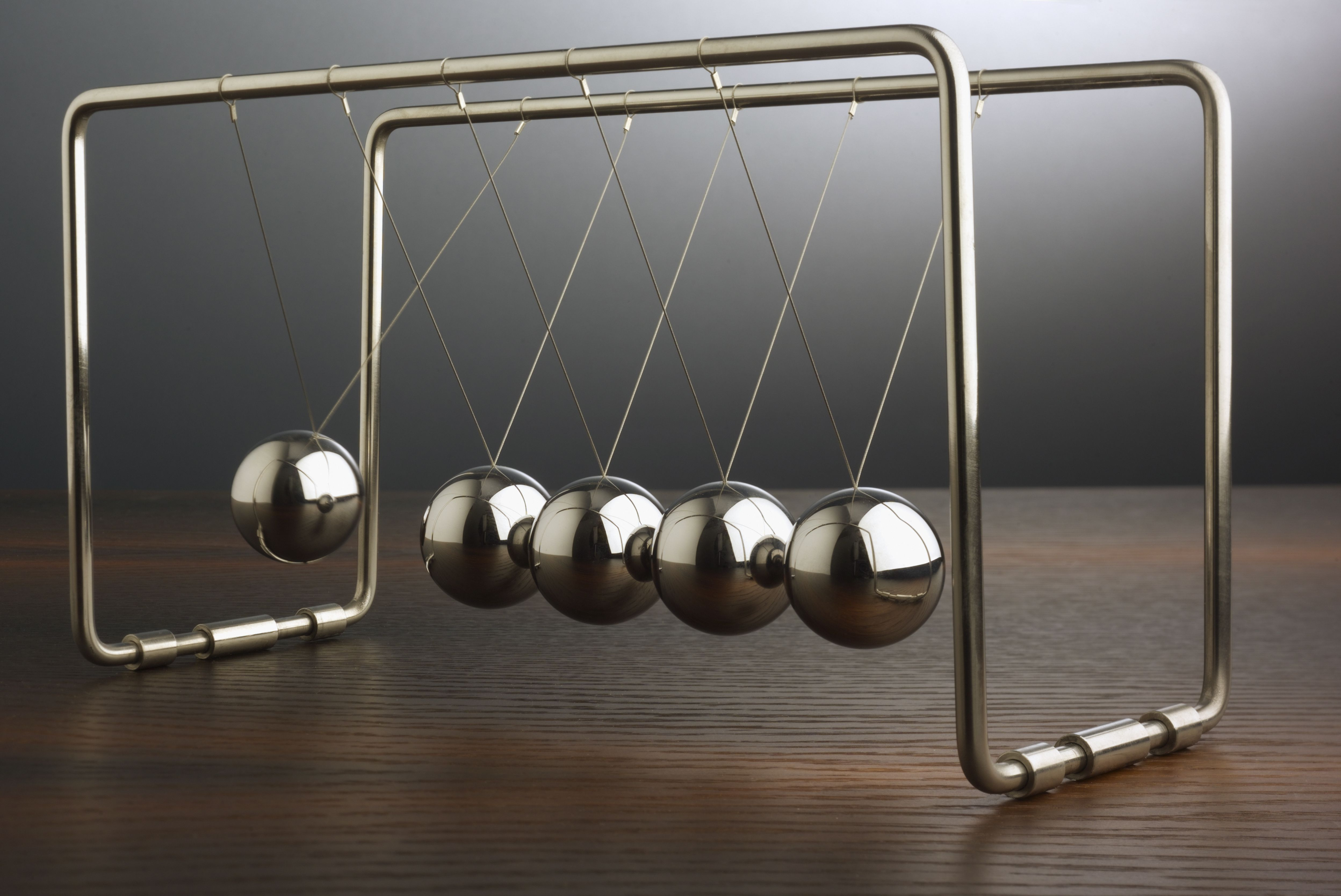 Close up of Newton's Cradle in motion.