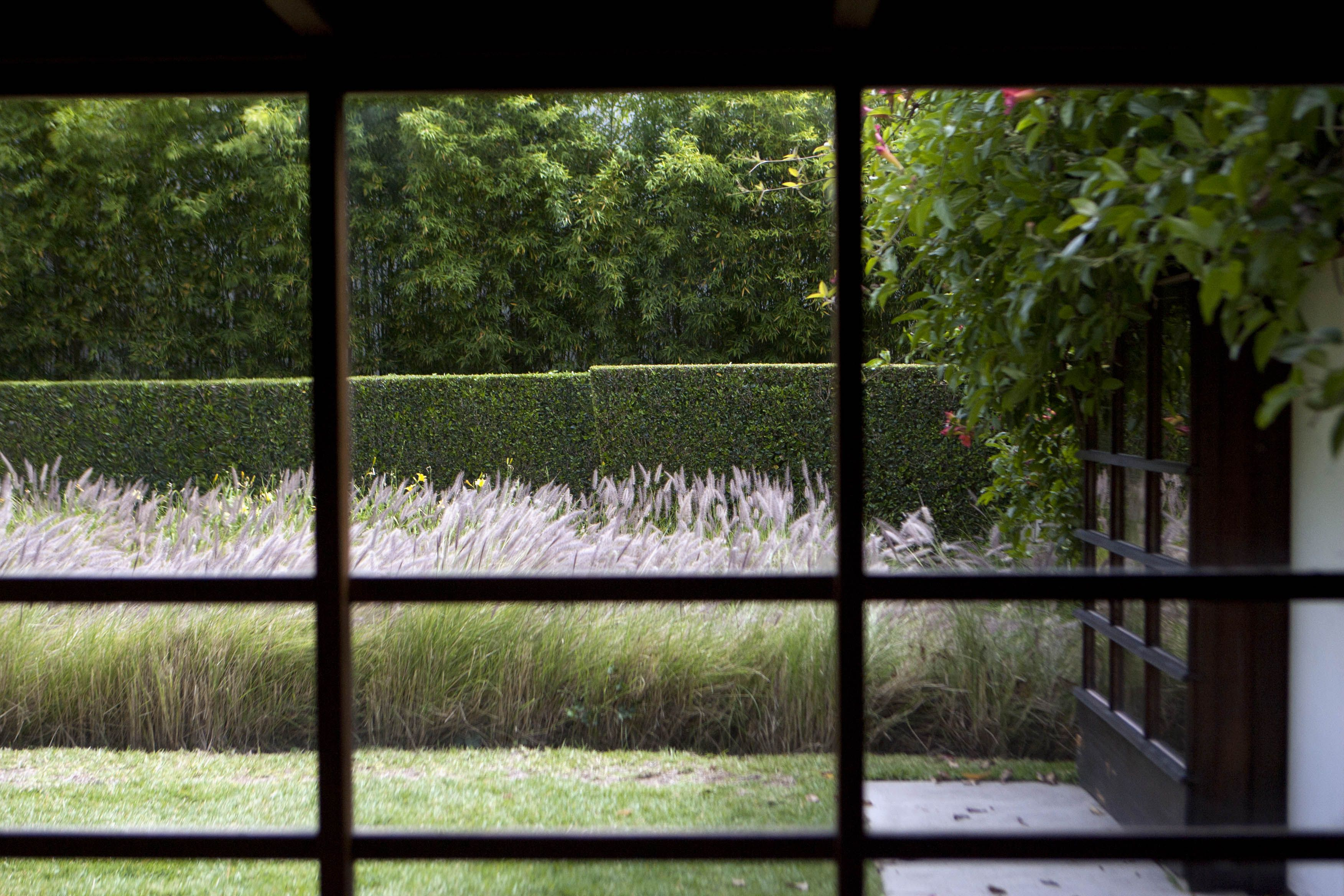 The garden seen from an interior room at the 1922 Schindler House in Los Angeles, California