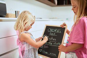 Girls creating chore list