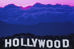 Los Angeles, sun behind clouds over Hollywood sign