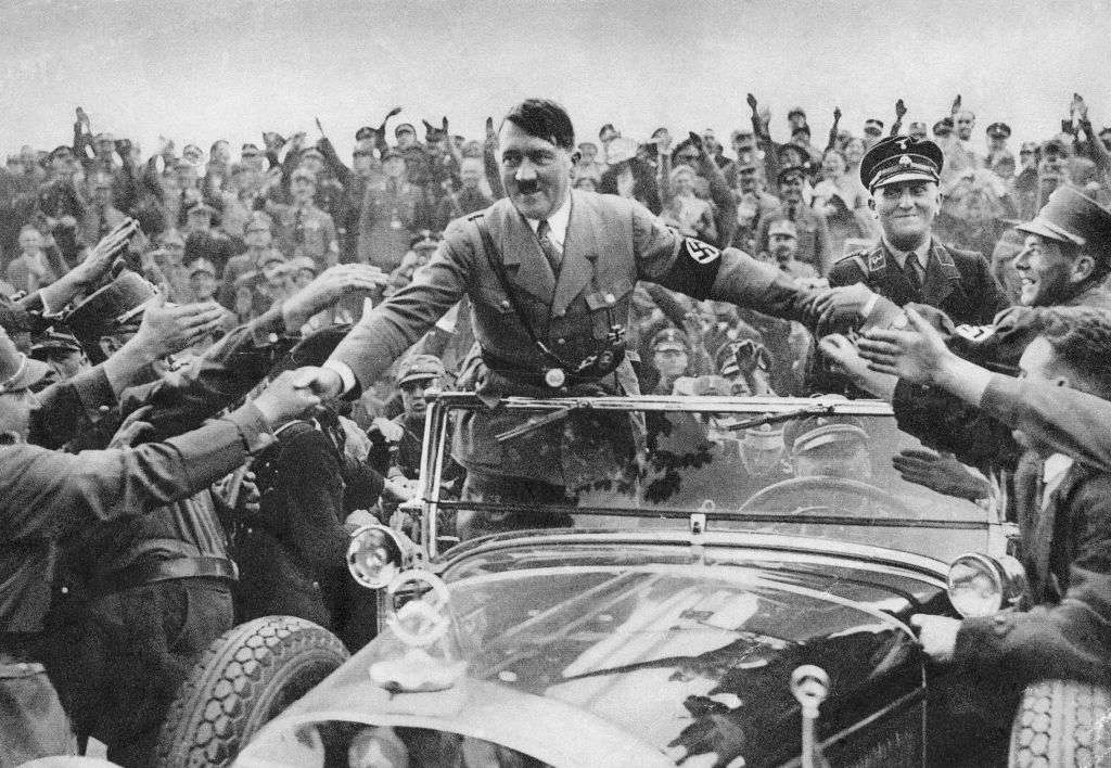 Adolf Hitler is welcomed by supporters at Nuremberg.