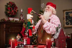 Santa Claus Painting Nutcracker in Toy Shop
