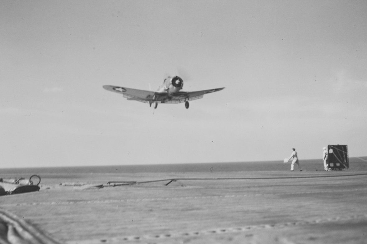 Single-engine diver bomber about to land on aircraft carrier USS Ranger.
