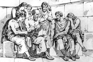 Socrates reads fro a scroll, teaching his doctrines to the young Athenians while awaiting execution