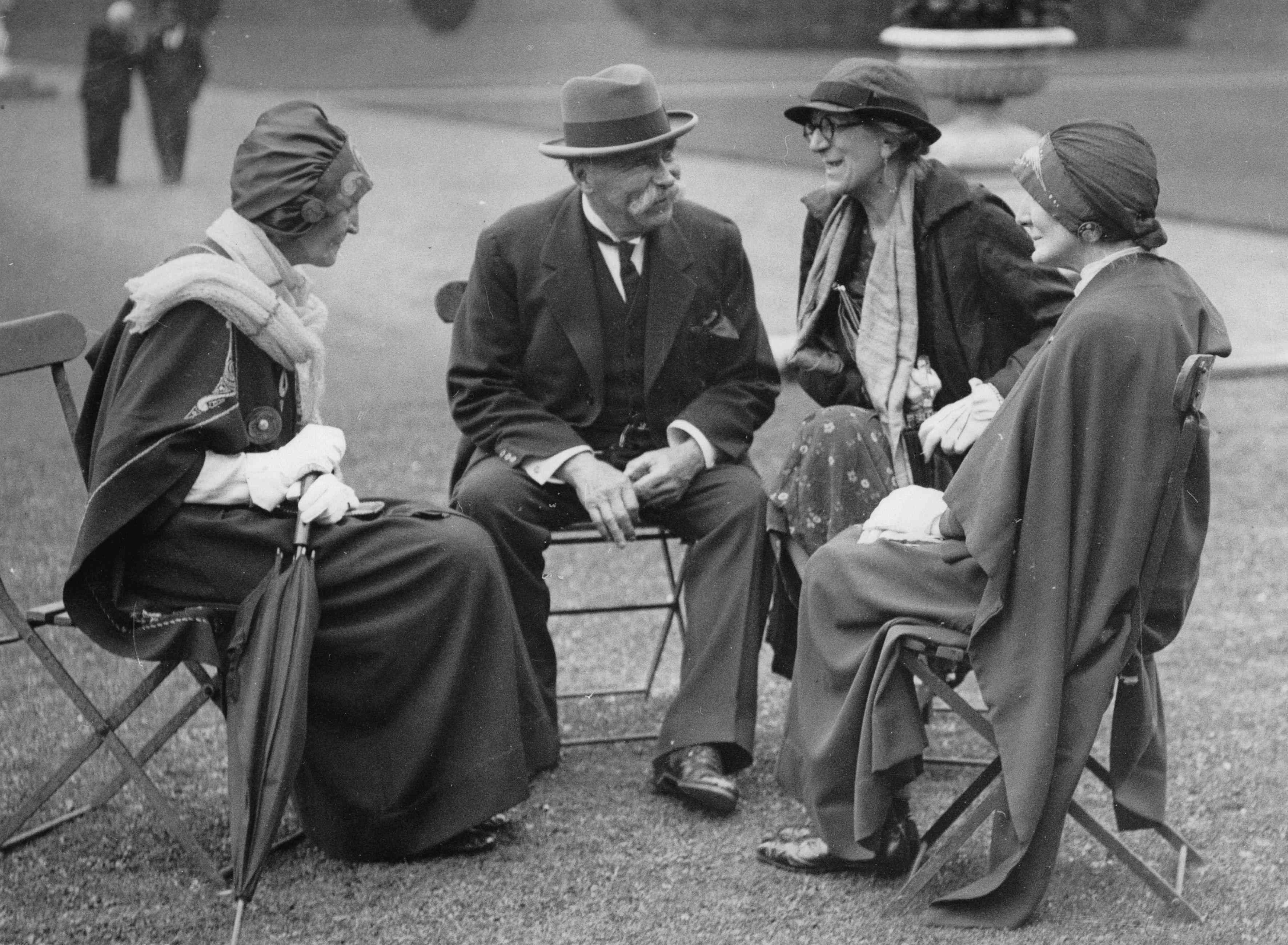 Dr Douglas Hyde (center, left) speaks with female citizens.