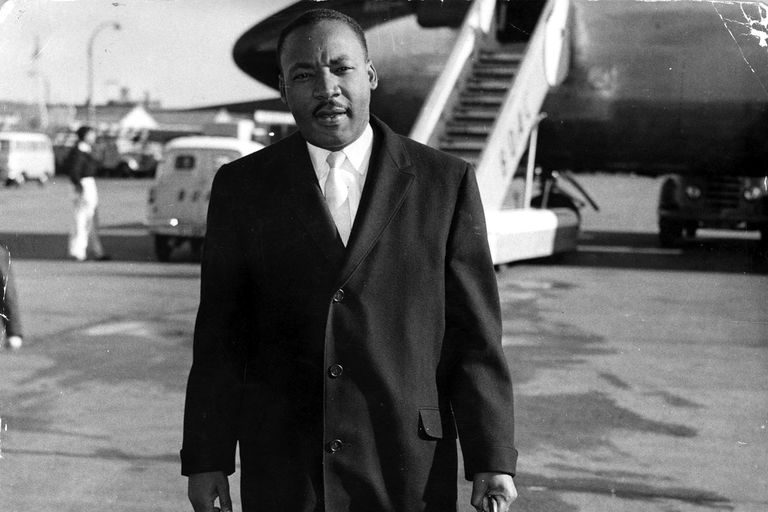 Martin Luther King on the tarmac in London after deplaning in October 1961