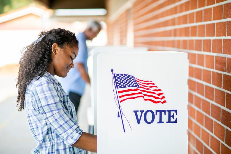 A young woman voting on election day