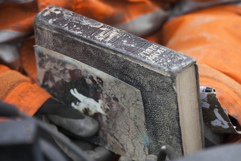 Flood damaged Bible and photographs. Photo: Getty Images/David Ryder/Stringer