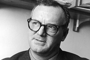 Black and white photo of C. Wright Mills.