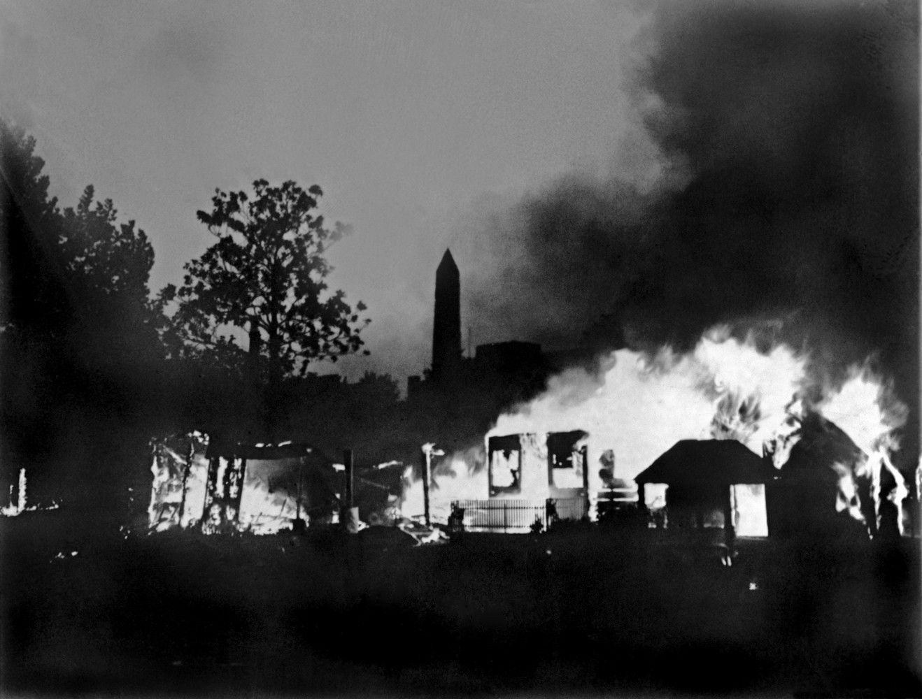 A Bonus Army veterans' encampment in Washington, D.C. being burned in 1932