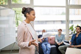 Businesswoman sharing her ideas in a presentation