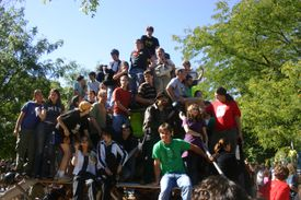 People stacked into a pyramid.