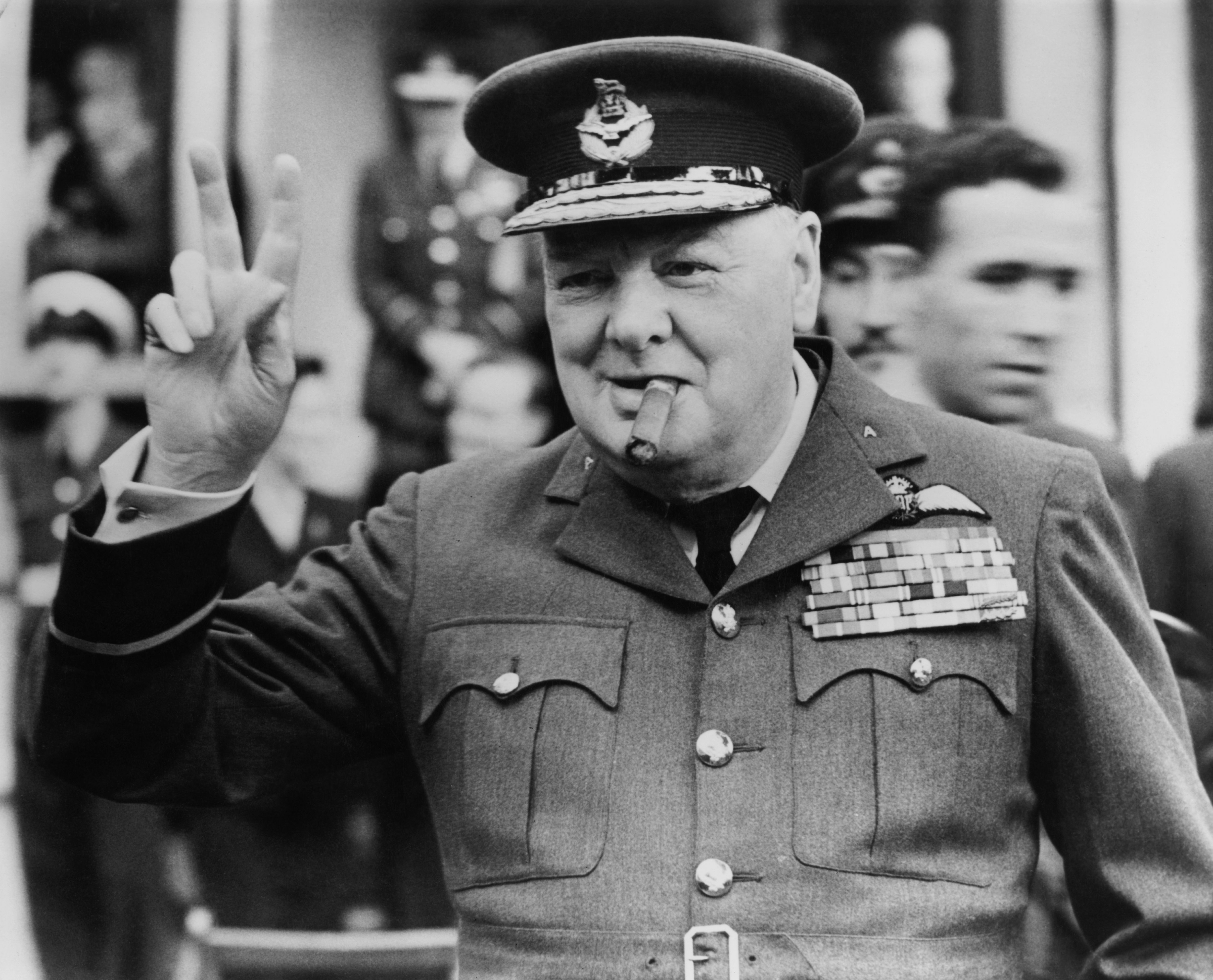 Churchill making peace sign in military outfit, in Croydon
