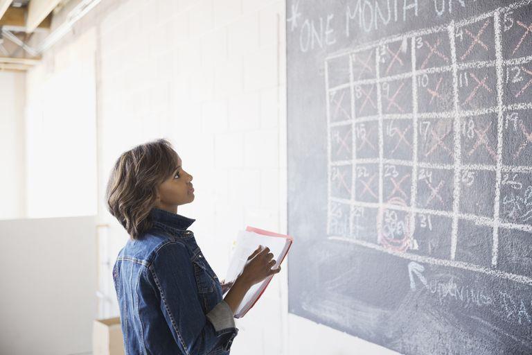 woman looking at wall calendar