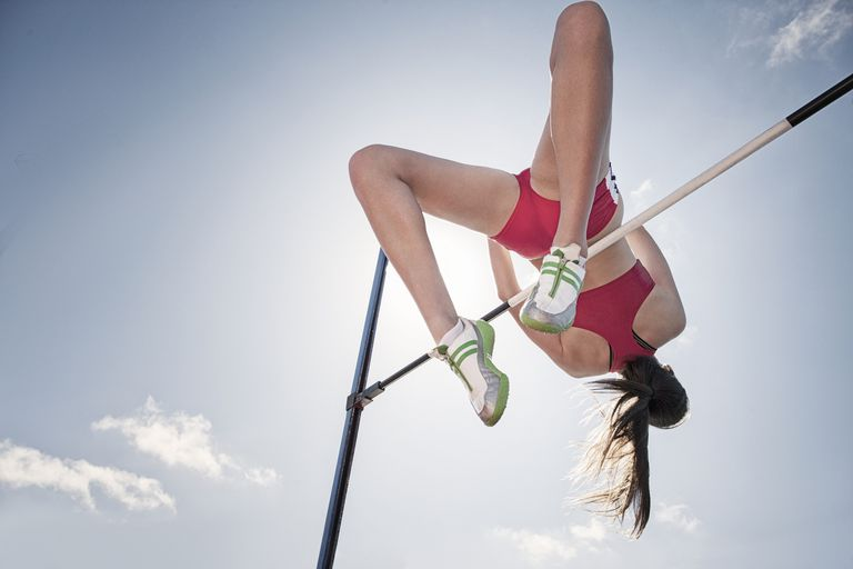 High jumper clearing the bar