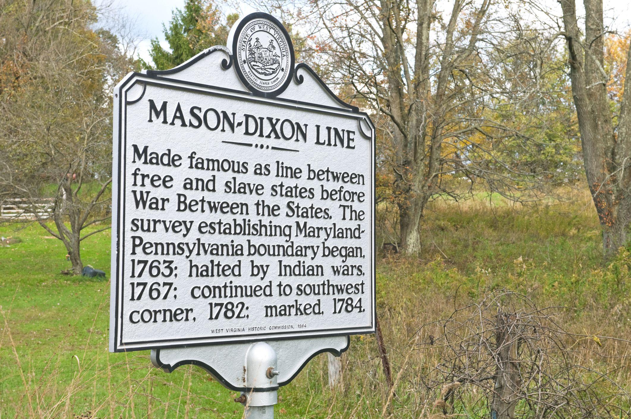 Sign marking historic Mason–Dixon Line