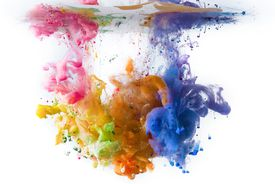 Multi-colored acrylic paints dissolving in water