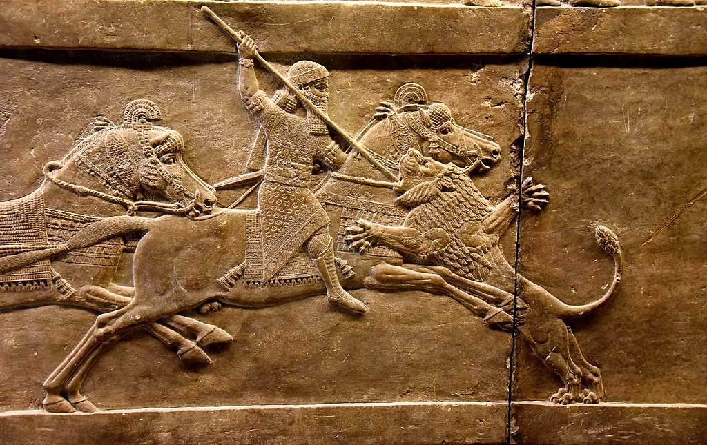 Assyrian king Ashurbanipal on his horse thrusting a spear onto a lion's head