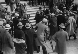 Photo of newsreel cameraman covering Teapot Dome