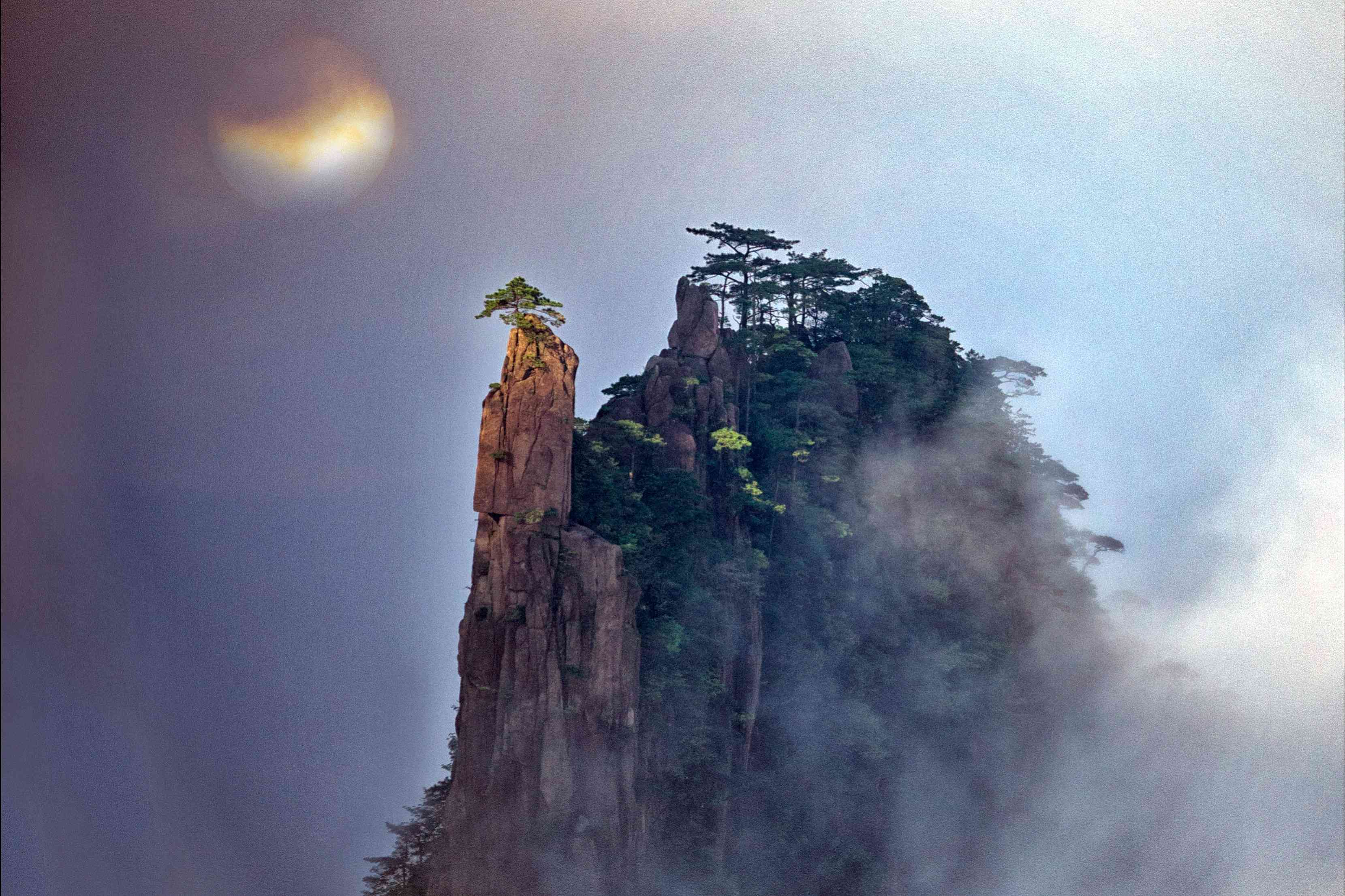 A peak at Huangshan Mountain National Park in Anhui wreathed in clouds