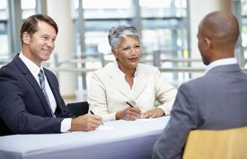 Businesspeople conducting an interview