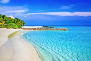 Beach and beautiful blue ocean under a bright blue sky.