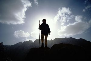 Egypt, Sinai Desert, hiker standing on rock