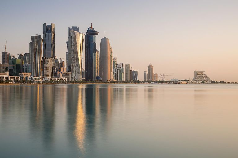 The skyline of Doha, Qatar's capital, reflects in the waters of the Persian Gulf.