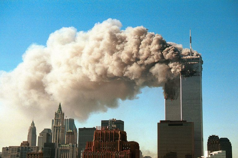 Smoke pours from the twin tower skyscrapers after being hit by two hijacked airliners in a terrorist attack September 11, 2001 in New York City