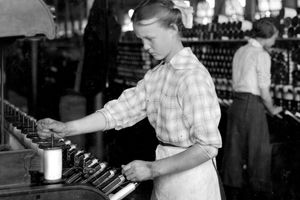 A fifteen-year-old girl works as a spooler tender at the Berkshire Cotton Mills, in Adams, Massachussetts, 1917.